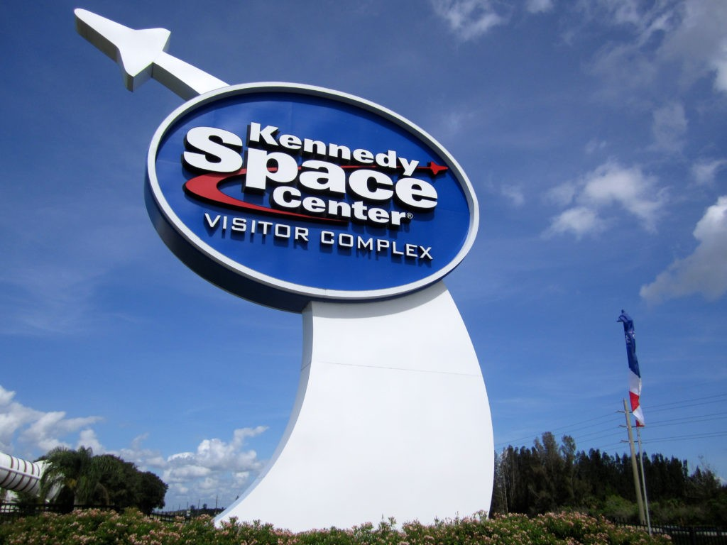 Cape Kennedy, Florida / USA - July 19, 2011: A large sign welcomes visitors to the Kennedy Space Center Visitor Complex on a hot summer morning.