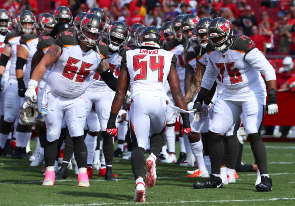 Nov 10, 2019; Tampa, FL USA;  Tampa Bay Buccaneers outside linebacker Lavonte David (54) greets his teammates after coming out of the tunnel before an NFL game.