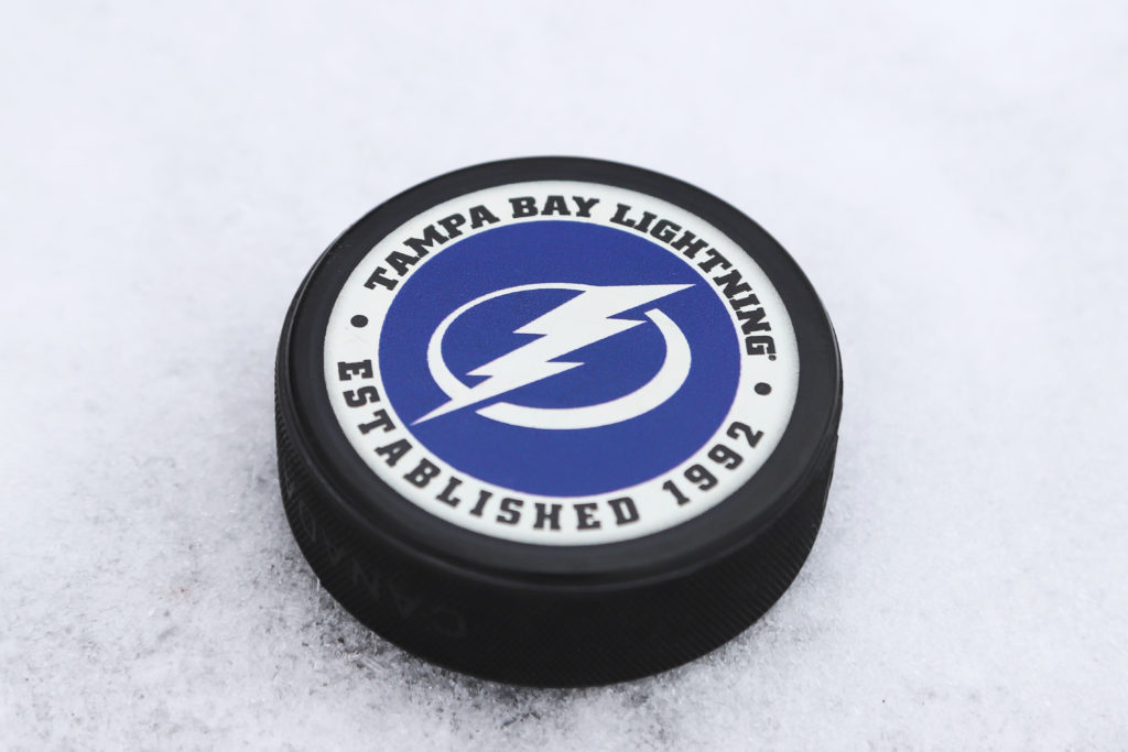 OREBRO, SWEDEN - MARCH 6, 2018: Ice hockey puck with Tampa bay lightning logo outdoor on ice in Orebro, Sweden