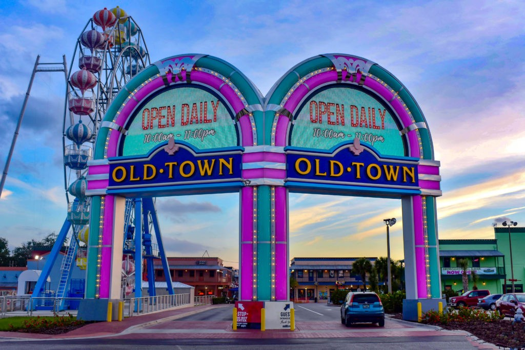 Orlando, Florida. December 28, 2018. Iluminated entrance arches and colorful big wheel at  Kissimmee Old Town in 192 Highway area .
