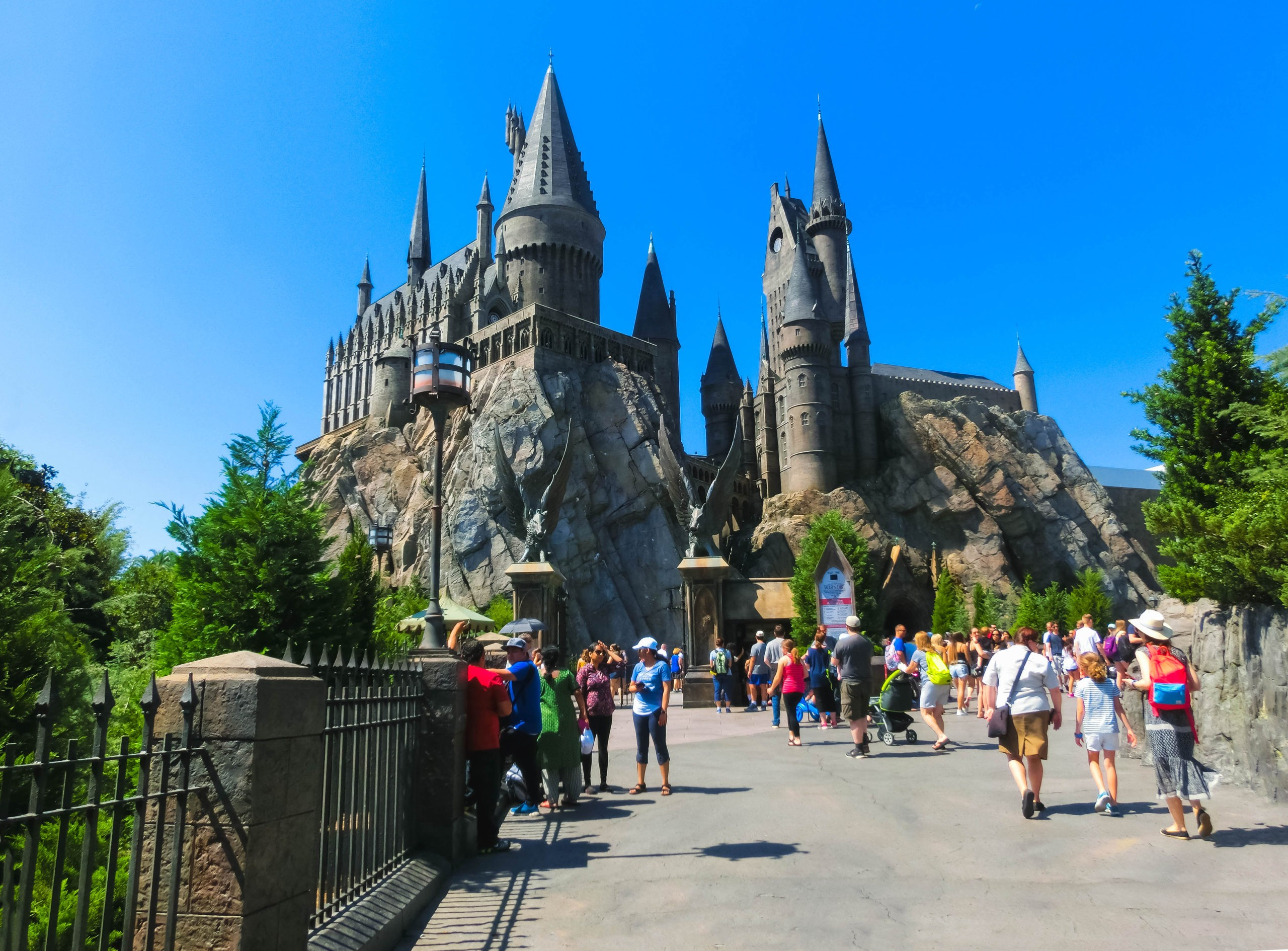 Orlando, Florida, USA - May 09, 2018: The people going to Hogwarts Castle at The Wizarding World Of Harry Potter in Adventure Island of Universal Studios Orlando. Universal Studios Orlando is a theme