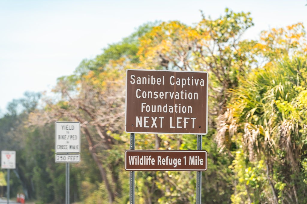Sanibel Island, USA - April 29, 2018: Captiva Conservation Foundation sign and national wildlife refuge park by beach and road in Fort Myers, Florida entrance