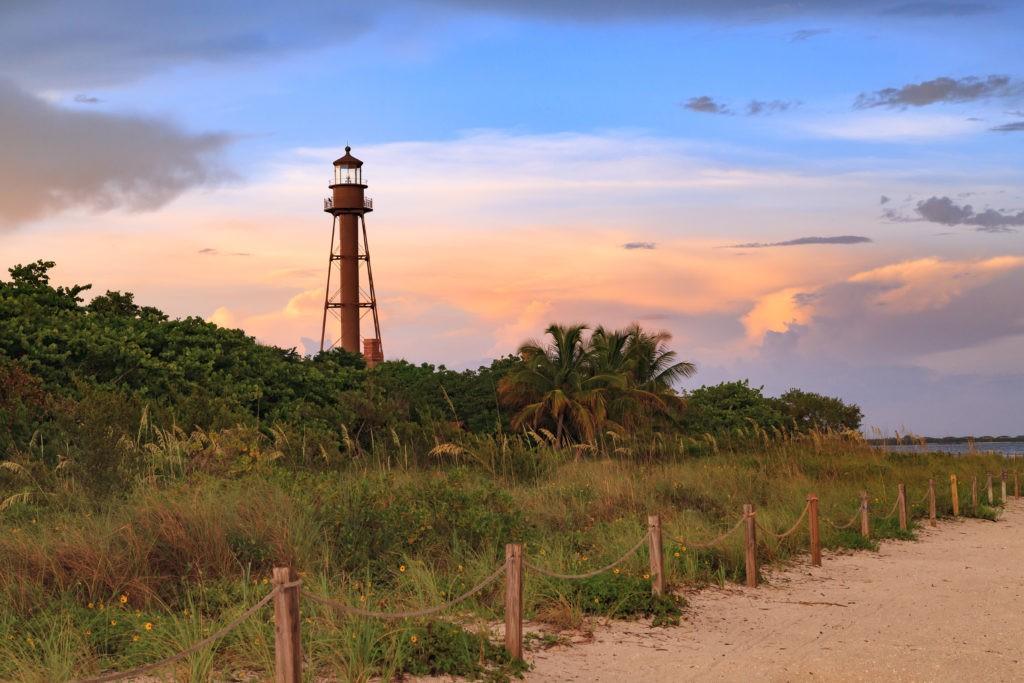 The Sanibel Island Lighthouse is framed against the late light from the setting sun, Sanibel Island, Florida, USA.