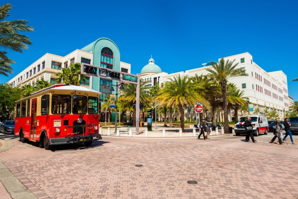 West Palm Beach, Florida - March 14, 2018: Cityscape view of the the popular West Palm Beach downtown district with City Hall along Clematis Street.