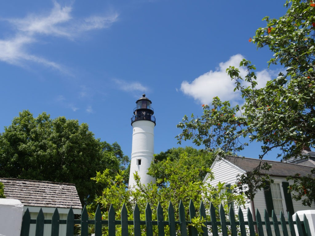 Wide shot of the Key West lighthouse  and the keeper's quarters. The lighthouse is a historical attraction in Key West, Florida.