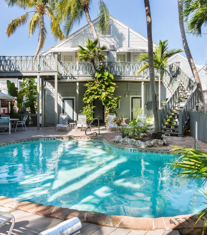 Key West arrow with beach background