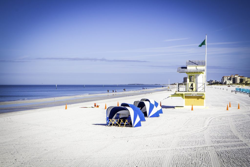 A beautiful morning on Clearwater Beach.  The sky is blue and the sand is freshly raked.