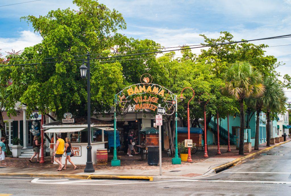 Key West, Florida, United States - July 10 2012: Bahama Village Market Entrance with Sign and Trees